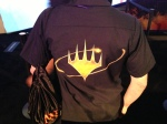 Back of WotC's shirt at the WotC Booth